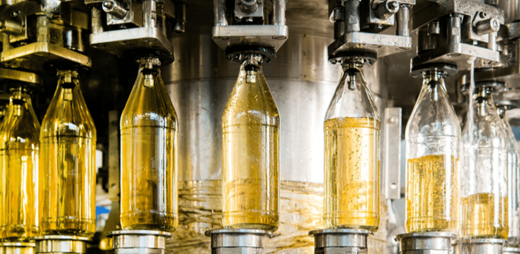 a machine filling bottles with carbonated liquid