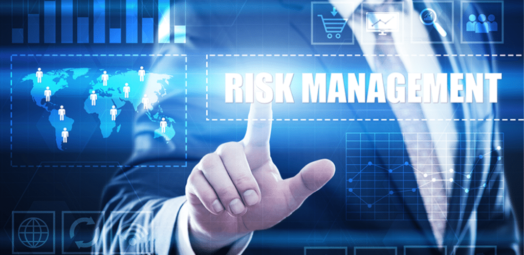 a person touches the word 'risk management'