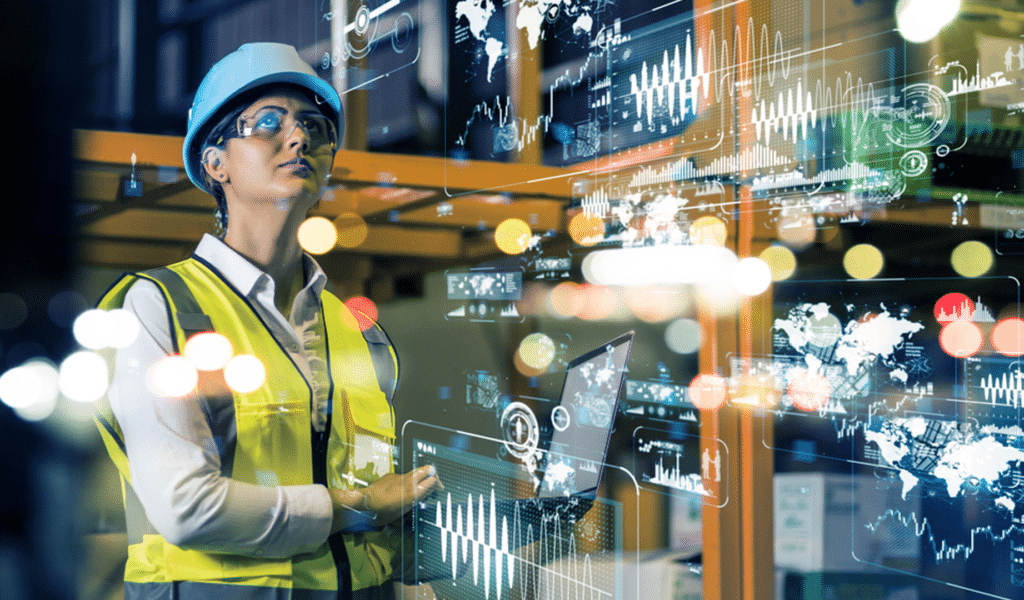 a feminine presenting person wearing a hard-hat looks at an artistic representation of data